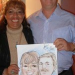 Customers holding their caricature