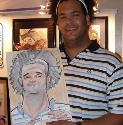 A guy holding his caricature