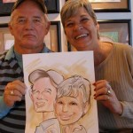 Guests holding their caricature